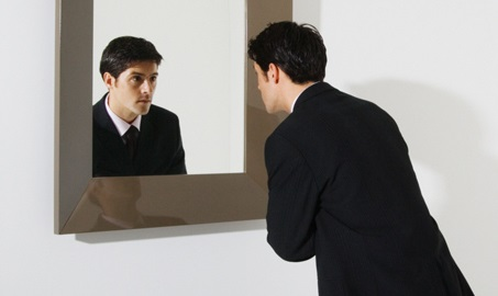 businessman-looking-in-mirror